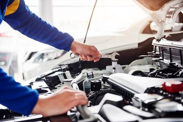 car mechanic fixing the engine
